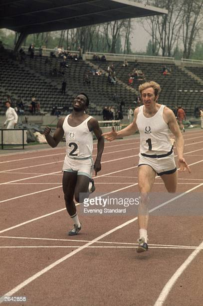 Athlete David Hemery crossing the finishing line during a hurdles event at Crystal Palace.