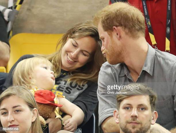 Athlete David Henson daughter Emily Henson and wife Hayley Henson with Prince Harry at the Sitting Volleyball Finals during the Invictus Games 2017...