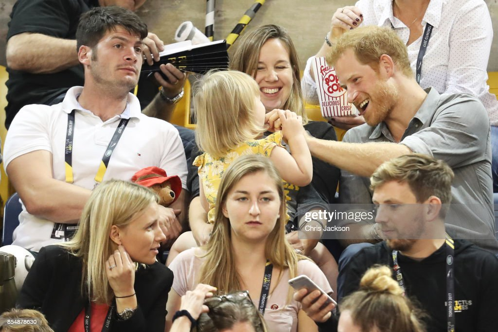 Athlete David Henson (L), wife Hayley Henson, daughter Emily Henson sit with Prince Harry at the Sitting Volleyball Finals during the Invictus Games 2017 at Mattamy Athletic Centre on September 27, 2017 in Toronto, Canada.