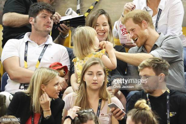 Athlete David Henson wife Hayley Henson daughter Emily Henson sit with Prince Harry at the Sitting Volleyball Finals during the Invictus Games 2017...