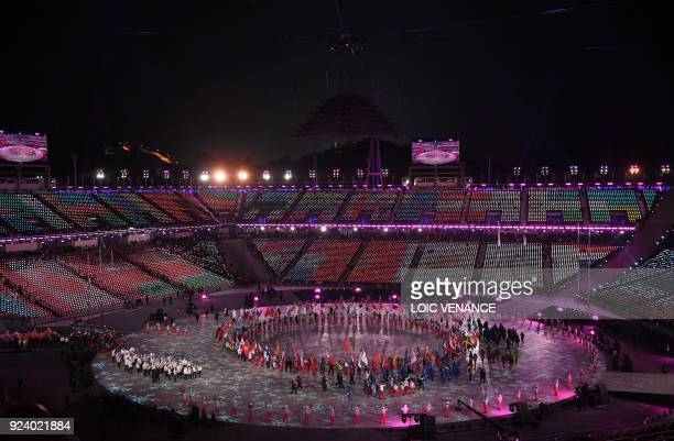 Athlete delegations parade during the closing ceremony of the Pyeongchang 2018 Winter Olympic Games at the Pyeongchang Stadium on February 25 2018 /...