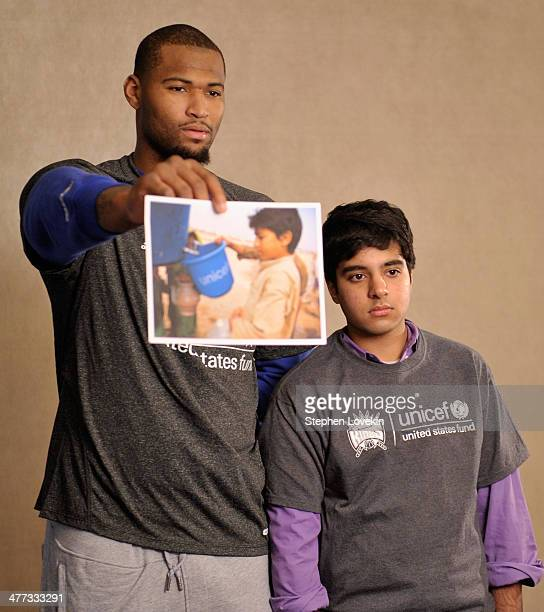 NBA athlete DeMarcus Cousins of The Sacramento Kings and a student from The United Nations International School attend an event recognizing New York...