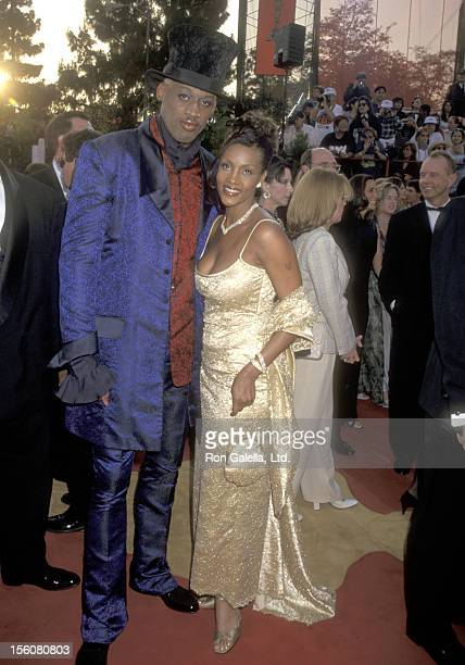 Athlete Dennis Rodman and Actress Vivica A Fox attend the 69th Annual Academy Awards on March 24 1997 at Shrine Auditorium in Los Angeles California