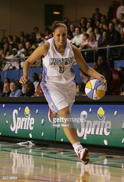 WNBA athlete Diana Taurasi moves the ball upcourt during the McDonald's NBA AllStar Celebrity Game at the Colorado Convention Center on February 18...