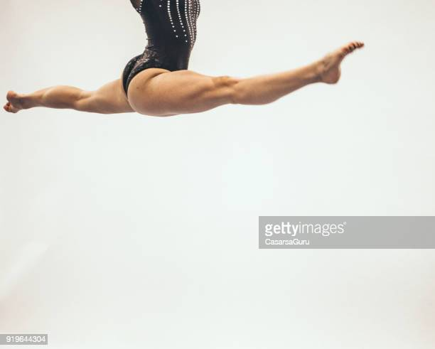 athlete doing a mid air split on white background - doing the splits stock pictures, royalty-free photos & images