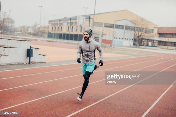 Athlete doing a sprint on running track
