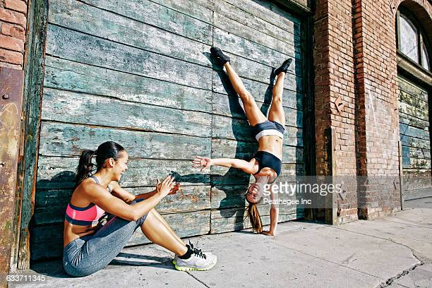 athlete doing handstand on sidewalk - showing off stock pictures, royalty-free photos & images