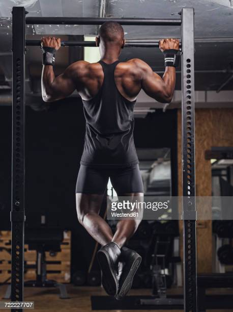 athlete doing push ups in gym - chin ups stock photos and pictures