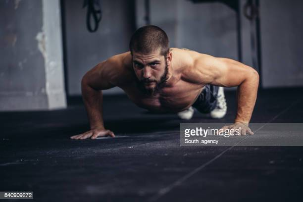 athlete doing push-ups - push ups stock pictures, royalty-free photos & images