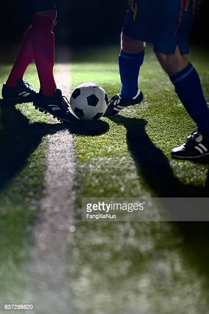 Athlete dribbling soccer ball on field
