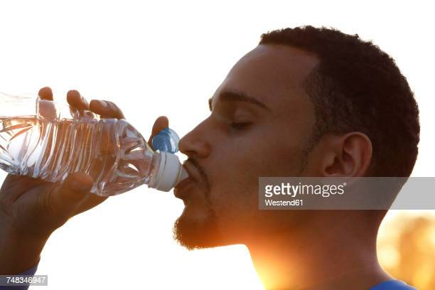 Athlete drinking water from bottle