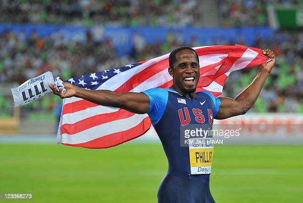 US athlete Dwight Phillips celebrates victory in the men's long jump final at the International Association of Athletics Federations World...