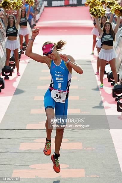 Athlete Elisabeth Gruber from Austria celebrates her second place in the women race of Ironman Barcelona on October 2 2016 in Calella near Barcelona...