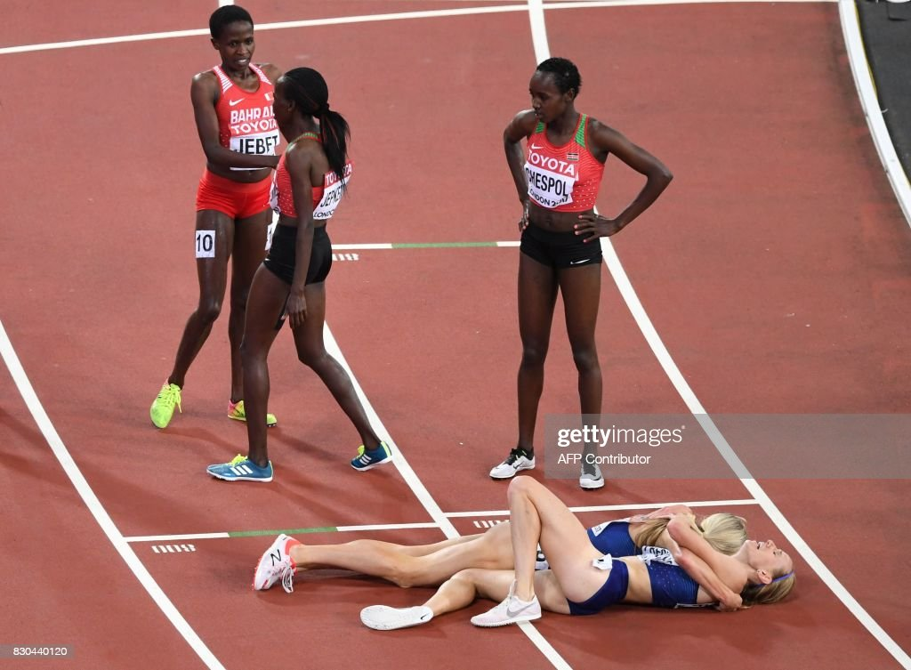 TOPSHOT - (From bottom L) US athlete Emma Coburn celebrates with US athlete Courtney Frerichs as Kenya's Hyvin Kiyeng Jepkemoi (topC), (from top L) Bahrain's Ruth Jebet (topL) and Kenya's Celliphine Chepteek Chespol (top R) look on after the final of the women's 3000m steeplechase athletics event at the 2017 IAAF World Championships at the London Stadium in London on August 11, 2017. US athlete Emma Coburn won ahead of US athlete Courtney Frerichs and Kenya's Hyvin Kiyeng Jepkemoi. /
