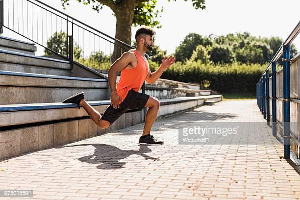 Athlete exercising on bleachers