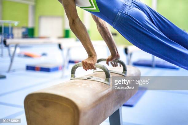 Athlete Exercising on Pommel Horse