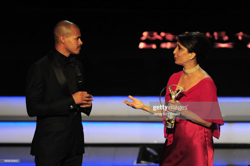 Athlete Felix Sanchez accepts his award for 'Laureus World Comebcak of the Year' from Laureus Academy Member Nawal El Moutawakel during the awards show for the 2013 Laureus World Sports Awards at the Theatro Municipal Do Rio de Janeiro on March 11, 2013 in Rio de Janeiro, Brazil.