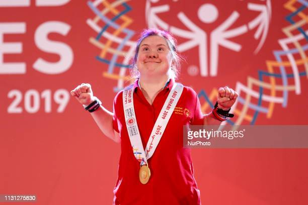 Athlete from Romania shows her emotions when receiving their medals during declaration ceremony at the Special Olympics World Games in Abu Dhabi...