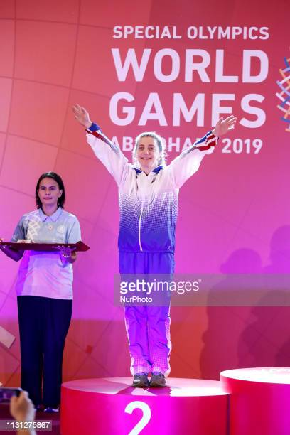 Athlete from USA shows her emotions when receiving their medals during declaration ceremony at the Special Olympics World Games in Abu Dhabi National...