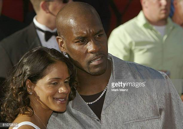 Athlete Gary Payton and wife Monique attend the 12th Annual ESPY Awards held at the Kodak Theatre on July 14 2004 in Hollywood California