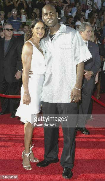 NBA athlete Gary Payton and wife Monique attend the 12th Annual ESPY Awards held at the Kodak Theatre on July 14 2004 in Hollywood California This...