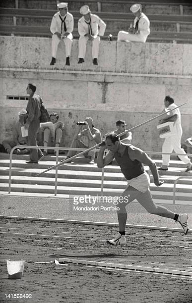 Athlete getting ready to throw the javelin during Rome Olympics Rome 1960