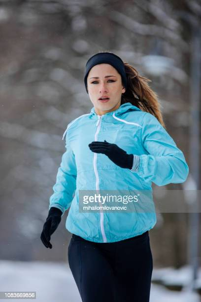 Athlete girl on the snow