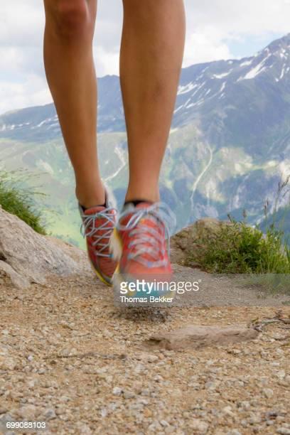 Athlete girl trail running in Chamonix