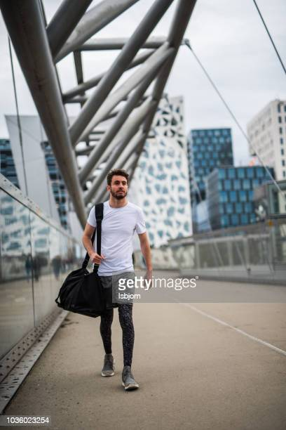 athlete going in the gym. - gym bag stock pictures, royalty-free photos & images