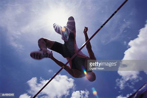 Athlete going over bar in high jump