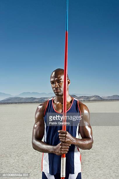 athlete holding javelin, portrait - el mirage dry lake stock photos and pictures