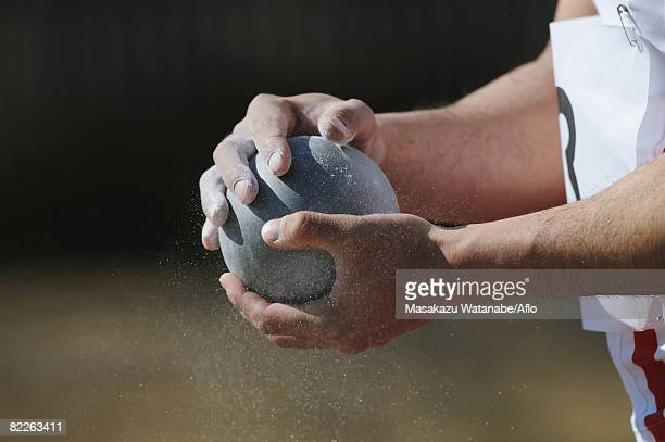 athlete holding metal ball - shot put stock pictures, royalty-free photos & images