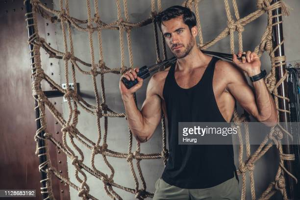 athlete holding resistance band - handsome stock pictures, royalty-free photos & images