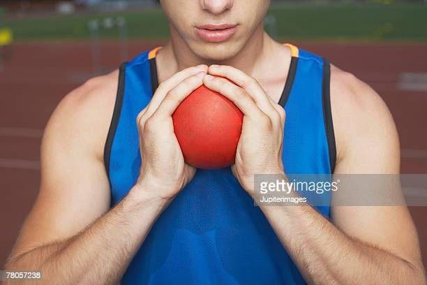 athlete holding shot put - shot put stock pictures, royalty-free photos & images