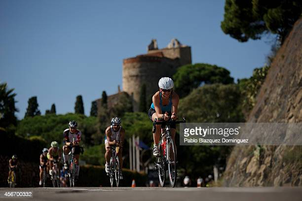 Athlete Hubert Madlen of Germany competes during the bike section of Ironman Barcelona on October 5 2014 in Calella city near Barcelona Spain
