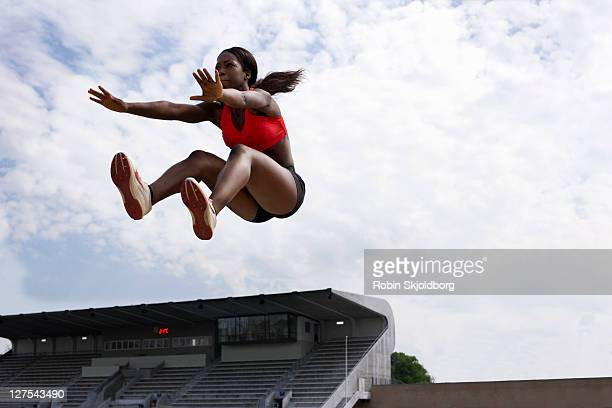 Athlete in midair during long jump