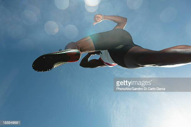 Athlete in midair, low angle view