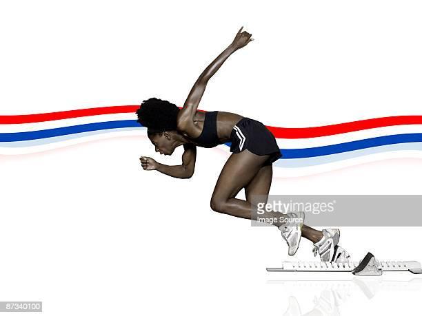 Athlete in starting blocks