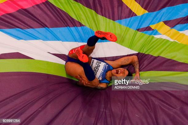 TOPSHOT US athlete Inika Mcpherson reacts as she fails at a jump in the women's high jump final at the 2018 IAAF World Indoor Athletics Championships...