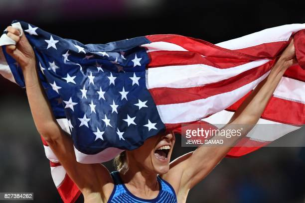 US athlete Jennifer Simpson celebrates her second place with the US flag after the final of the women's 1500m athletics event at the 2017 IAAF World...