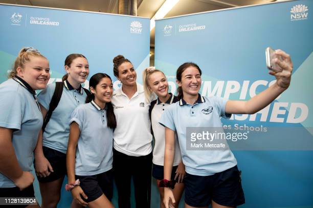 Athlete Jess Fox poses with students during the Australian Olympic Committee and NSW Government Program Launch Event at Cranebrook High School on...