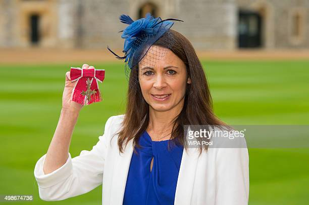 Athlete Jo Pavey with her Member of the Order of the British Empire medal which was presented to her at an investiture ceremony at Windsor Castle on...