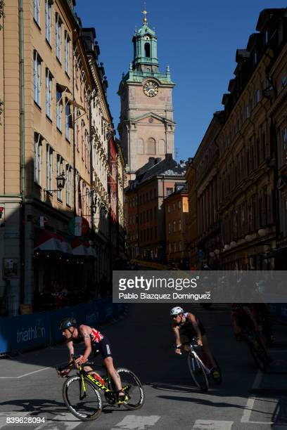 Athlete Jonathan Brownlee from Great Britain and Dorian Coninx from France compete on the bike leg during the men's Elite race of Vattenfall World...