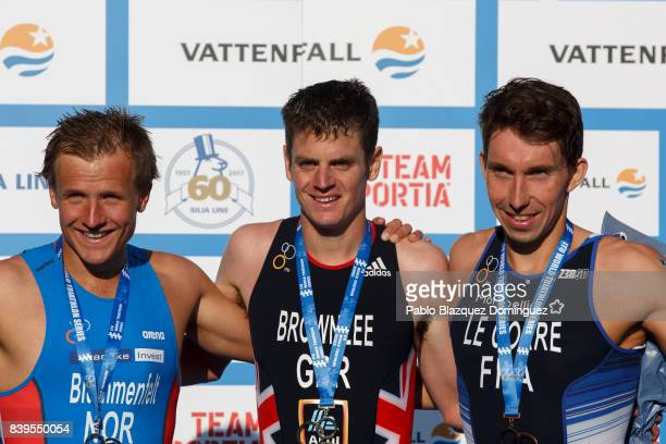 Athlete Jonathan Brownlee from Great Britain celebrates winning the men's Elite race of Vattenfall World Triathlon Stockholm with Kristian...