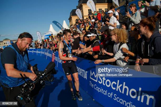 Athlete Jonathan Brownlee from Great Britain celebrates with the spectators winning the men's Elite race of Vattenfall World Triathlon Stockholm on...