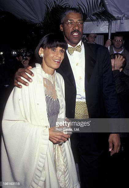 Athlete Julius Erving and wife Tuquoise Erving attend Cartier Tank Francaise Watch Launch Party on May 8 1996 at B Altman Store in New York City