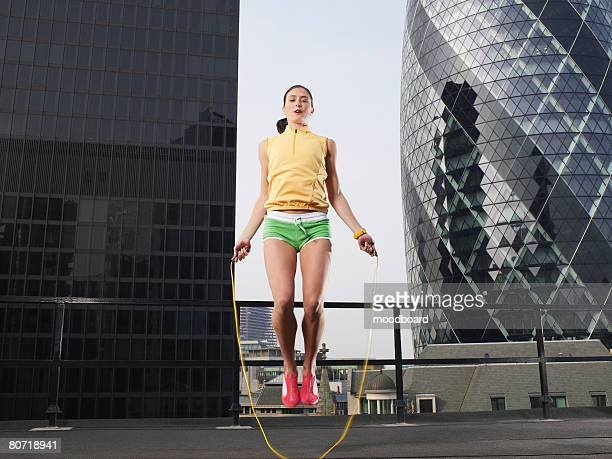 athlete jumping rope downtown - headquarters stock pictures, royalty-free photos & images