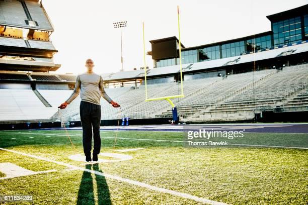 Athlete jumping rope during workout in stadium