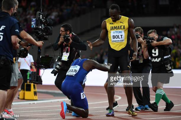 TOPSHOT US athlete Justin Gatlin bends down to Jamaica's Usain Bolt after the final of the men's 100m athletics event at the 2017 IAAF World...