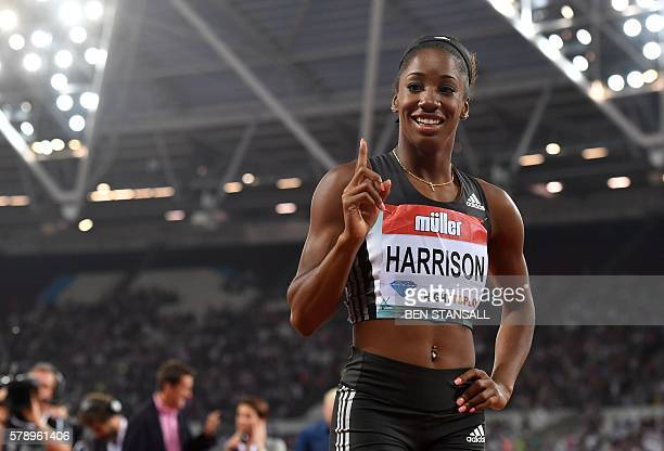 US athlete Kendra Harrison poses for a photograph after she wins the final of the women's 100m hurdles in a new world record time of 1220 at the IAAF...